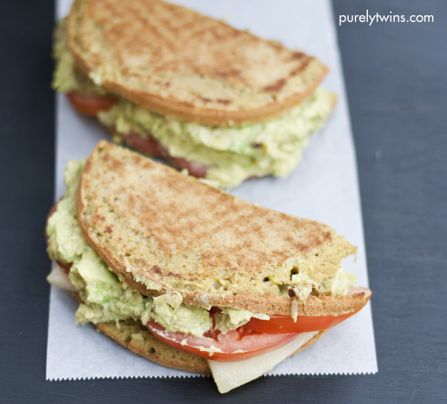 Grown-up grilled cheese sandwich. Layers of cheese, tomatoes, and ...
