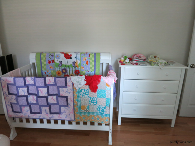 baby girl white crib and dresser