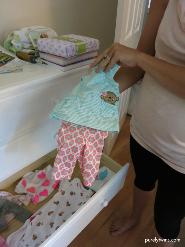 holding new born baby girl outfit