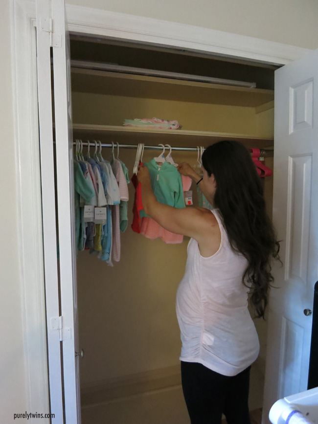 lori hanging baby clothes
