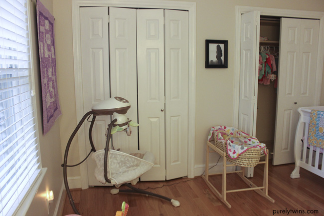 first time mom decorating nursery room for baby girl