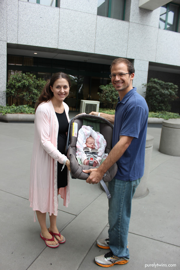 new-family-leaving-hospital-after-birth-of-first-child