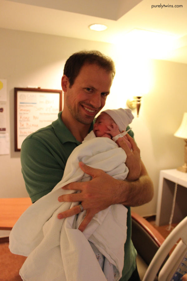 a-happy-new-dad-holding-baby-girl-at-hospital-after-labor