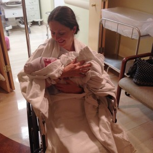 new-mom-and-baby-girl-newborn-at-hospital-leaving-birthing-room