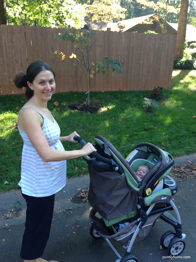 newmom-taking-baby-on-walk-in-stroller