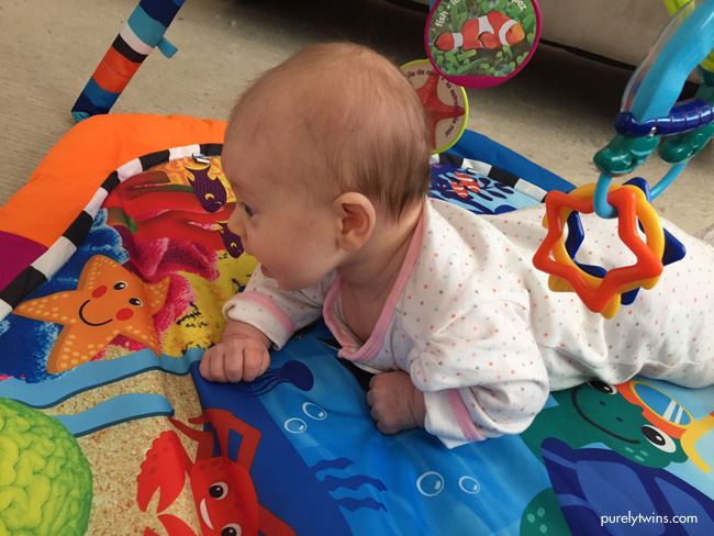 2-month-old-doing-tummy-time-holding-head-up-purelytwins