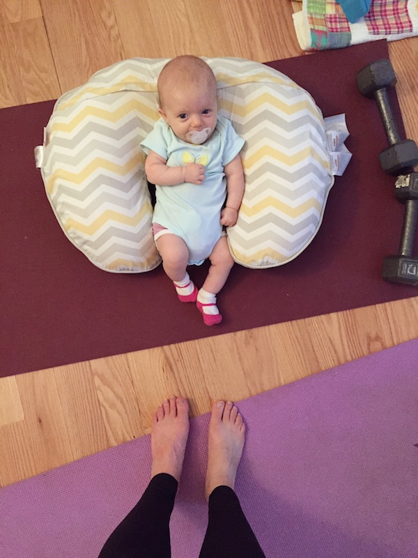 baby girl watching mom workout