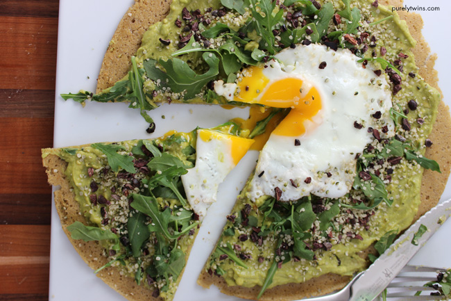 runny-egg-breakfast-pizza-topping-with-arugula-avocado-cream-hempseeds-purelytwins