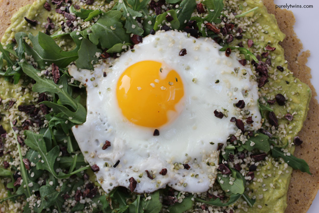 The ultimate breakfast PIZZA with avocado cream and sunny side up egg with hemp seeds and cacao nibs. Gluten-free, grain-free breakfast pizza that will fuel you for your busy day ahead. Quick and healthy breakfast pizza. Made from real foods.