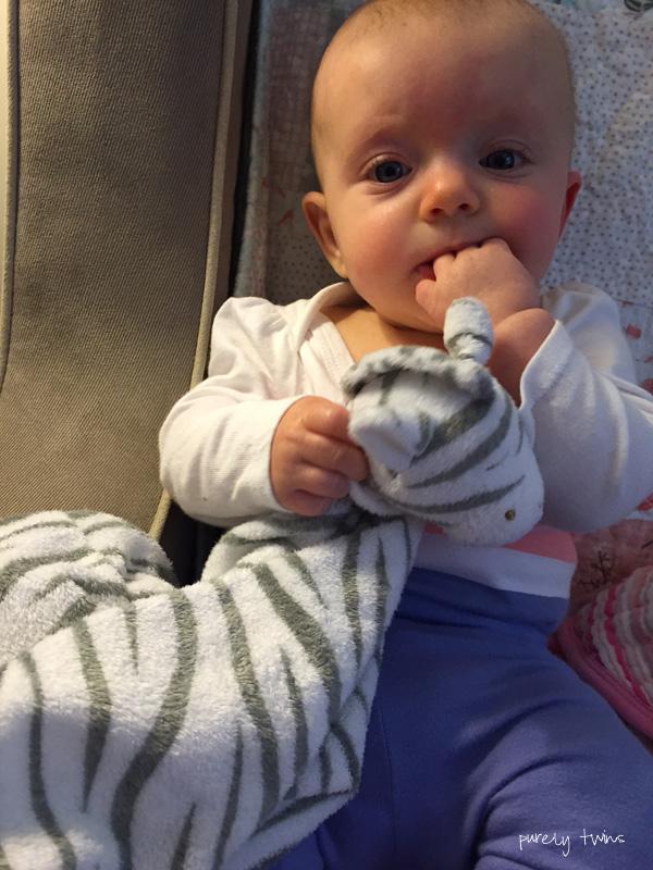 baby-girl-holding-zebra-blanket-angel-dear