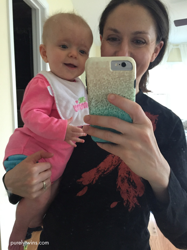 holding-5month-old-baby-girl-for-selfie-in-mirror