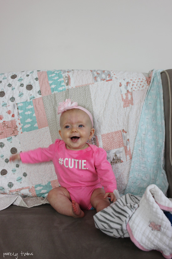 6 month old baby girl laughing for her update new mom sharing her journey purelytwins.com