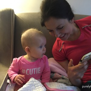 michelle-sitting-with-baby-madison-looking-at-iphone