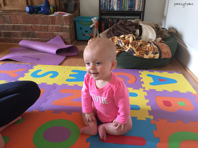 cute-baby-playing-on-mat