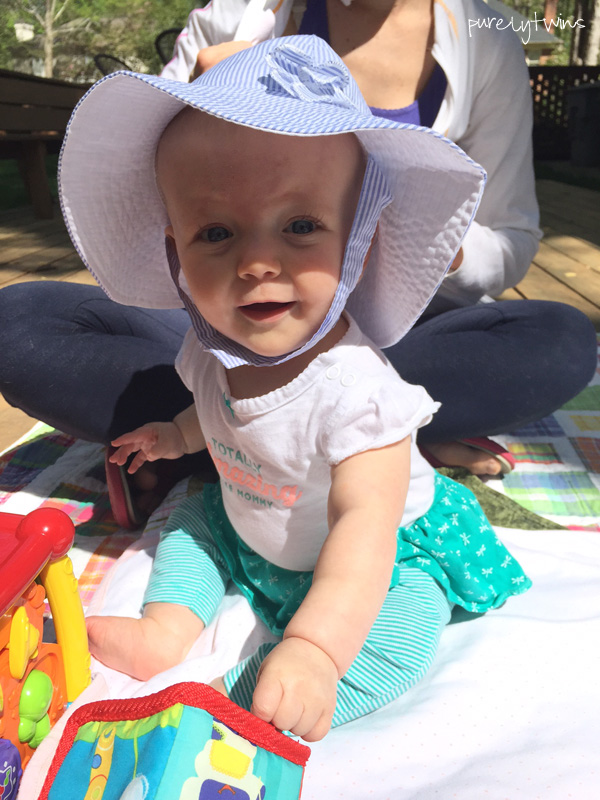 7 month old wearing a hat to protect her from the sun #newmom #baby || purelytwins.com