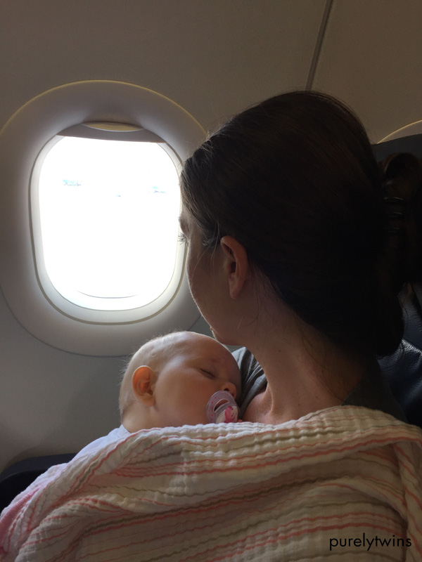 baby girl who is 8 months old sleeping on mom during first plane ride #newmom #babygirl