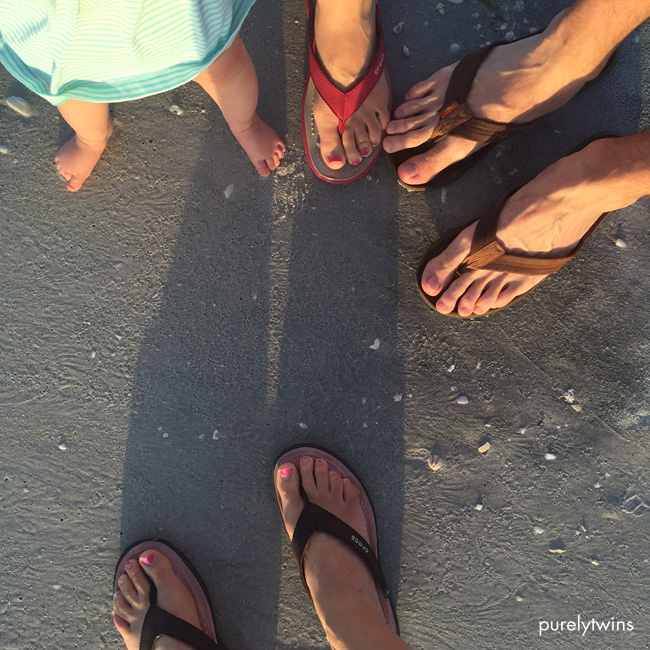 family-feet-sand-beach