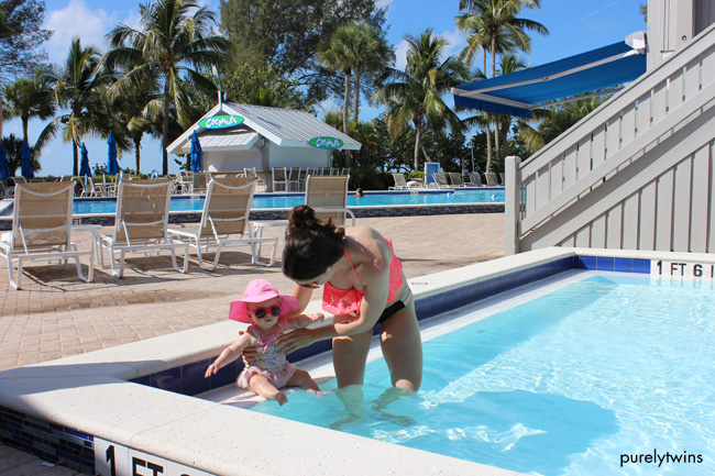 playing-in-kiddy-pool-at-casa-ybel-sanibel-resort-purelytwins