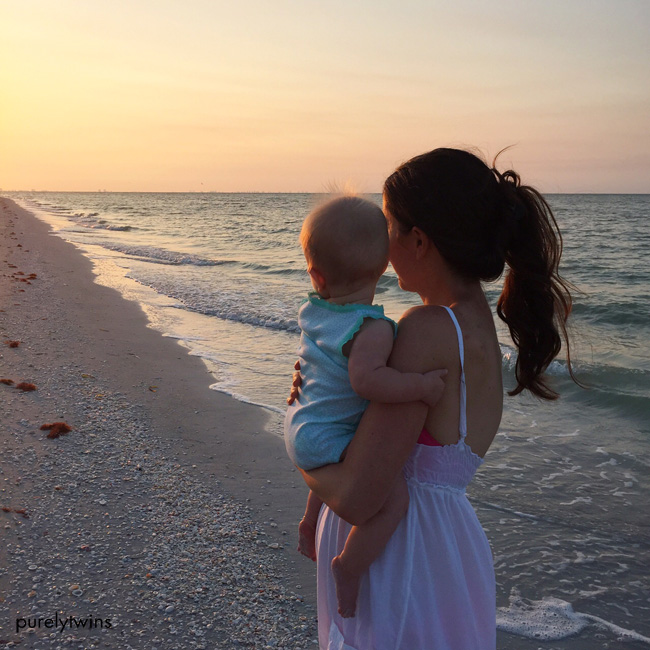 watching sunrise on sanibel beach with 8 month old baby and mom