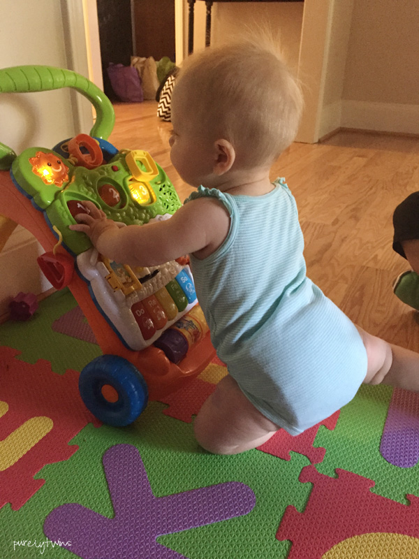 9-month-old-grabbing-onto-toys-pulling-herself-up-purelytwins