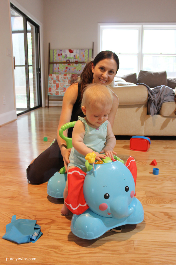 Madison-loves-her-elephant-to-ride-around-the-house-purelytwins