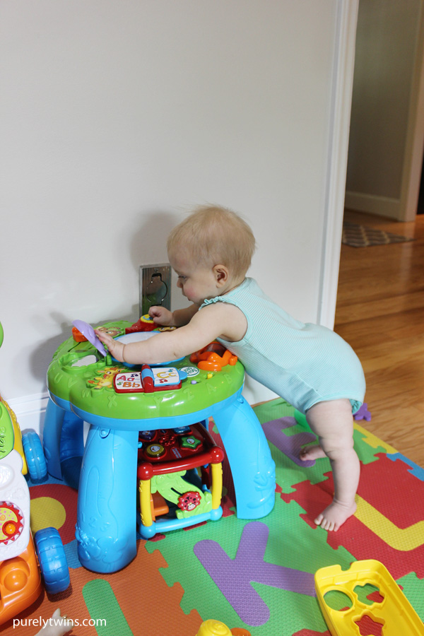 Madison-standing-and-playing-at-10-months-old-purelytwins