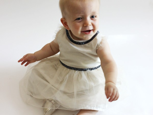 11 month old baby girl wearing Carter's dress and Freshly Picked moccains