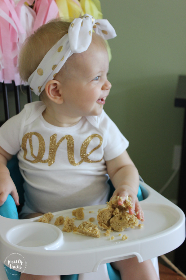 Madison-cute-smile-while-eating-her-first-birthday-cake-at-party-purelytwins