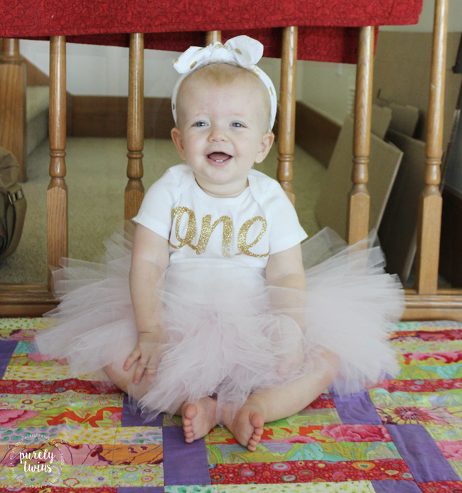 Madison wearing her birthday outfit. BespokedCo from Etsy baby girls first birthday outfit pink and gold.