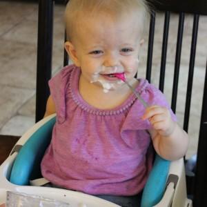 baby-girl-eating-yogurt