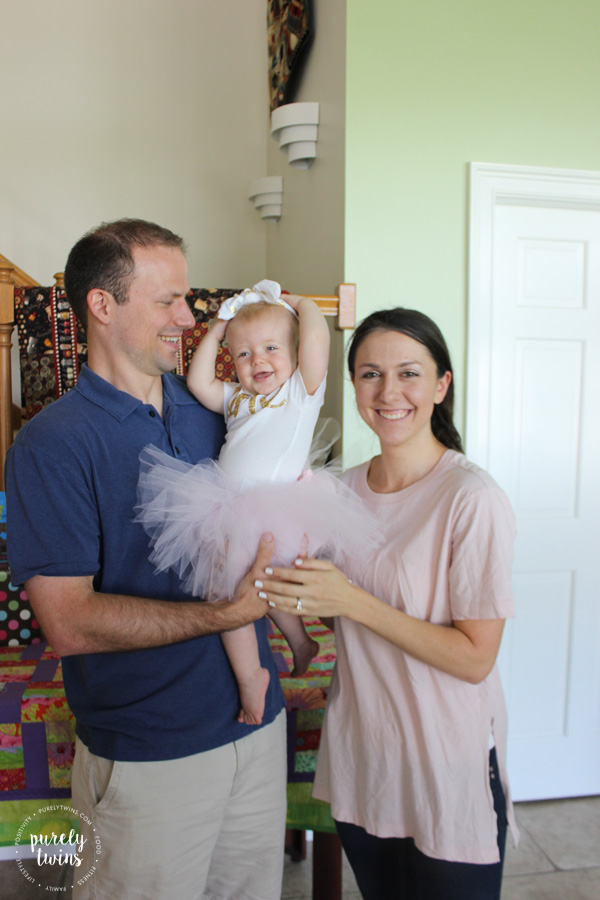 baby-girl-laughing-family-birthday-photo