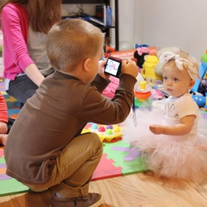 toddler-taking-a-picture-of-one-year-old-cousin