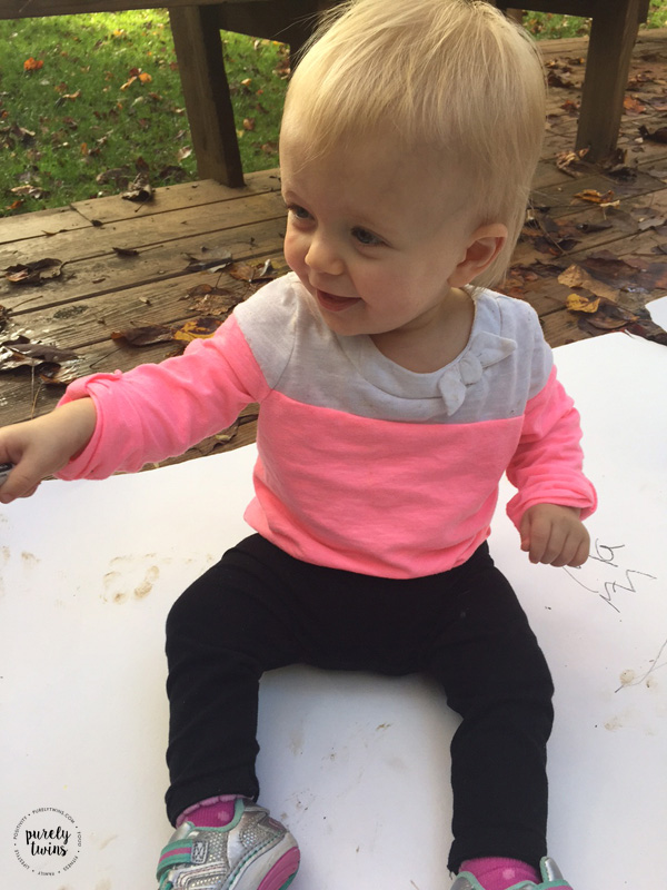 madison-sitting-outdoors-playing