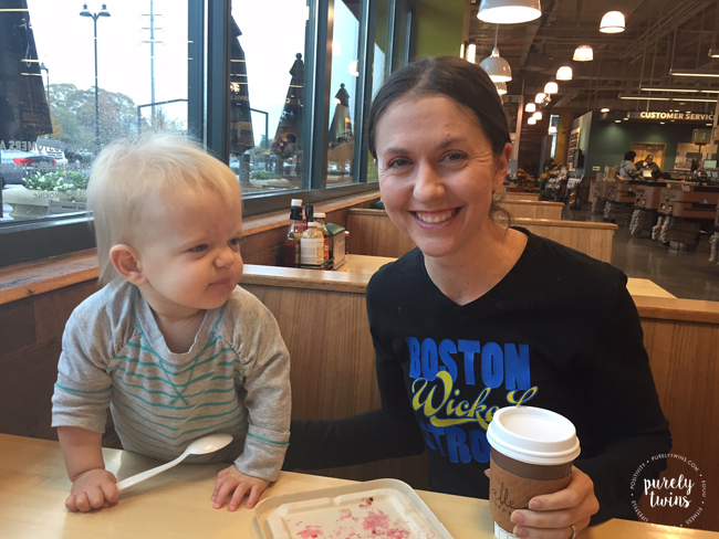 mom and 13 month old daugther eating at wholefoods for breakfast