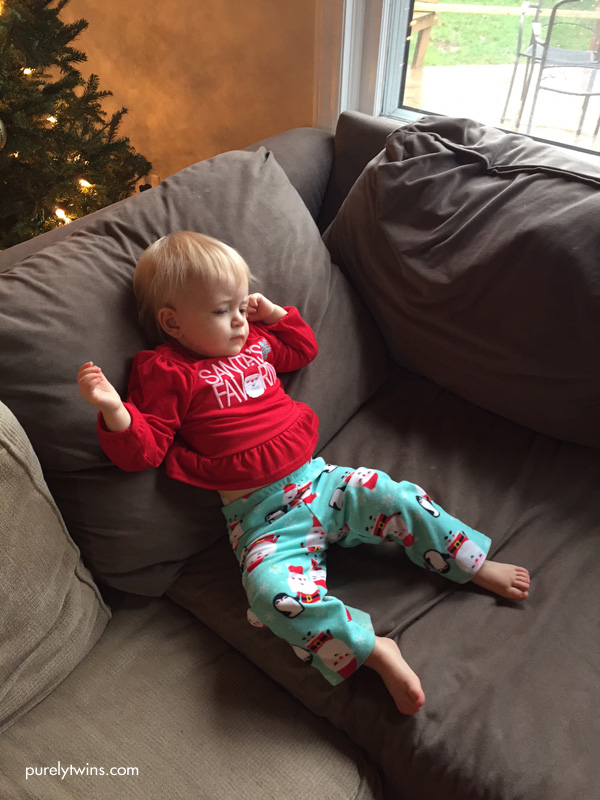 15 month old relaxing on couch watching Christmas movie
