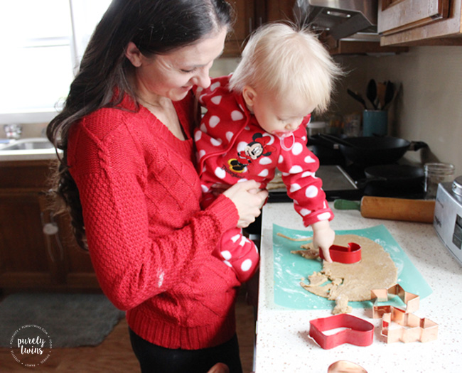 Toddler helping out in the kitchen with making santa sugar cookies