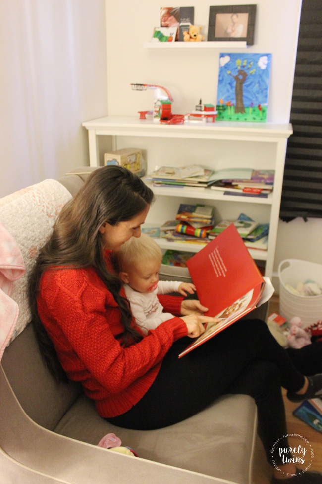 Reading the Night Before Christmas with toddler to create new family holiday traditions.