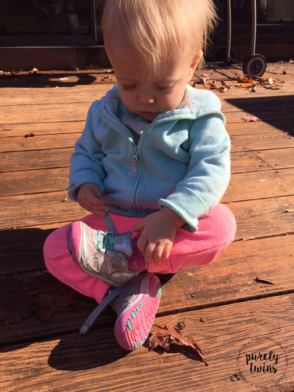 baby-girl-playing-with-velcro-on-tennis-shoes