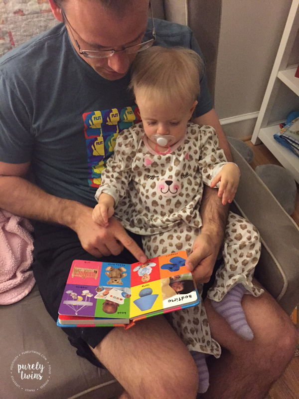 Daddy reading bedtime stories to his 14 month old baby girl. Importance of dad's being in daughter's life.