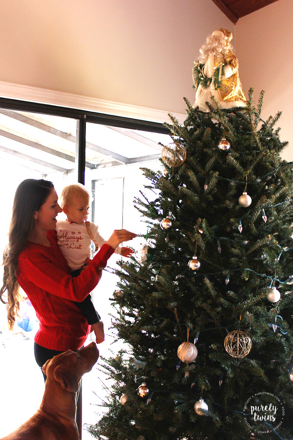 Simple and fun family tradition with a toddler is letting them help decorate the Christmas tree.
