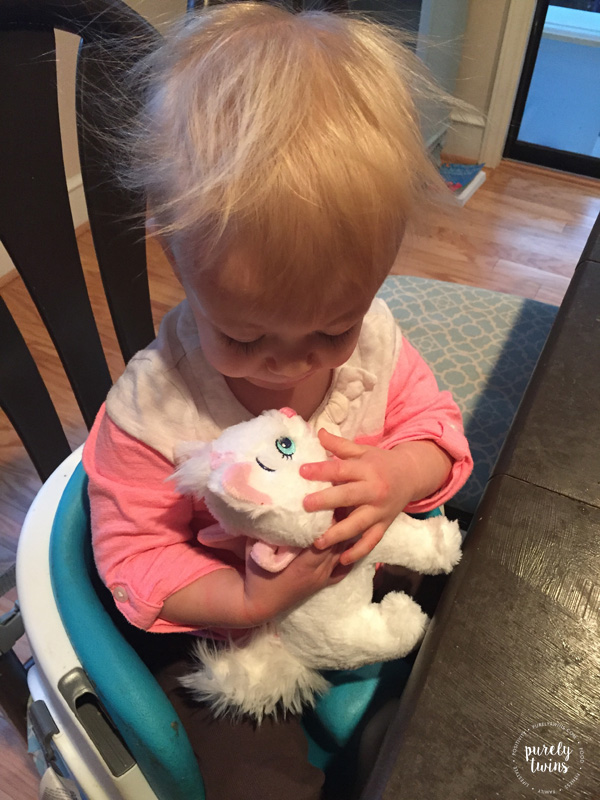 baby-girl-with-new-toy-cat-stuffed-animal
