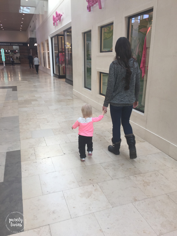 Mom and 16 month old daughter walking around in the mall.
