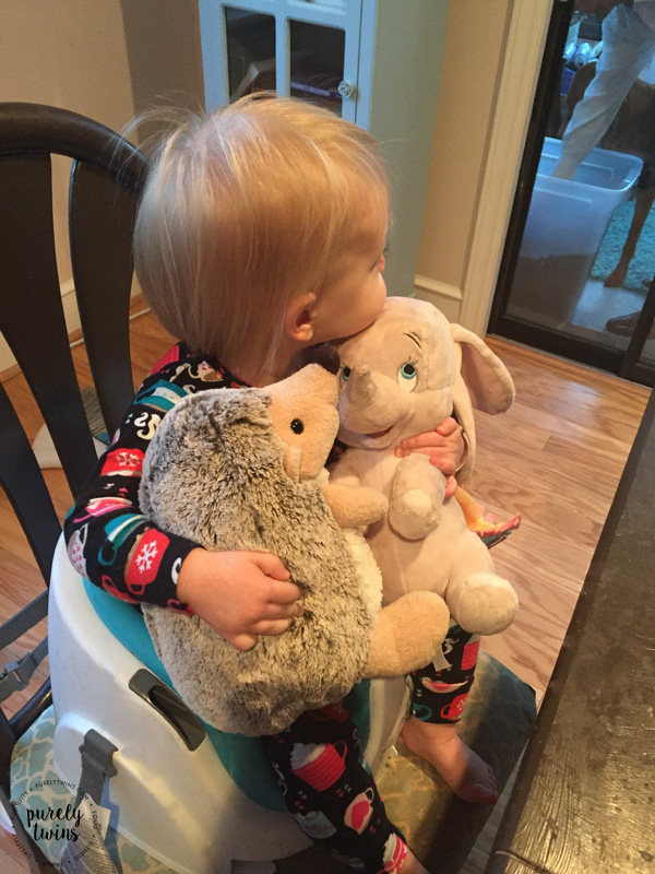 Toddler taking her stuffed animals with her everywhere even to breakfast.