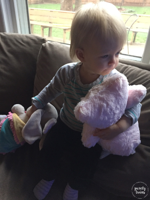 little-girl-with-her-stuffed-animals