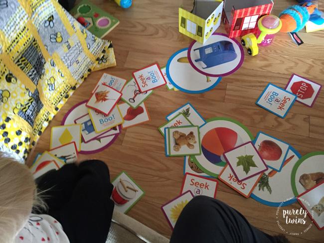 Toddler game. Playing seek a poo memory card game.