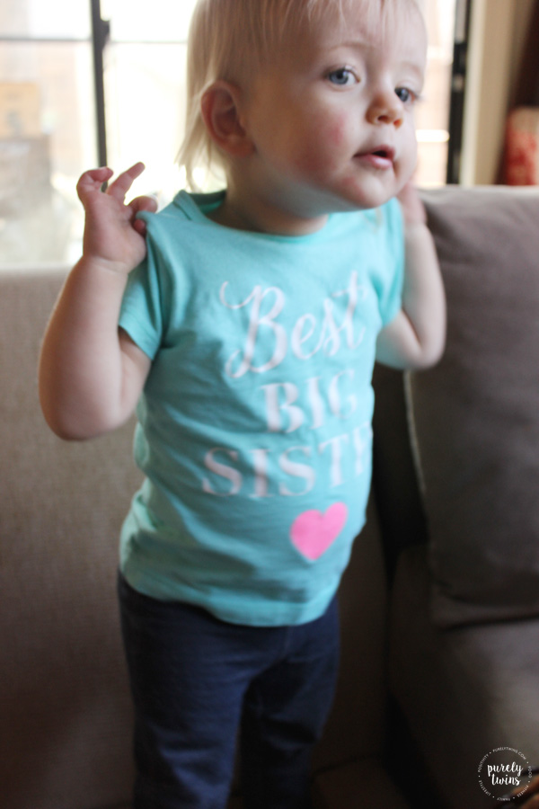 Big sister showing off her best big sister shirt for baby #2 announcement.