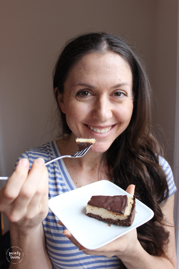 Enjoying a yummy slice of no bake chocolate peanut butter cheesecake.
