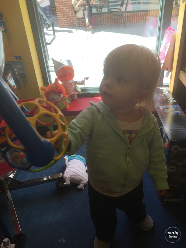 18-month-old-playing-at-toy-store-in-charlotte