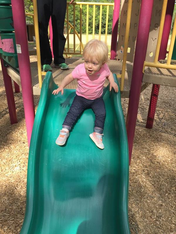Going down slide at playground