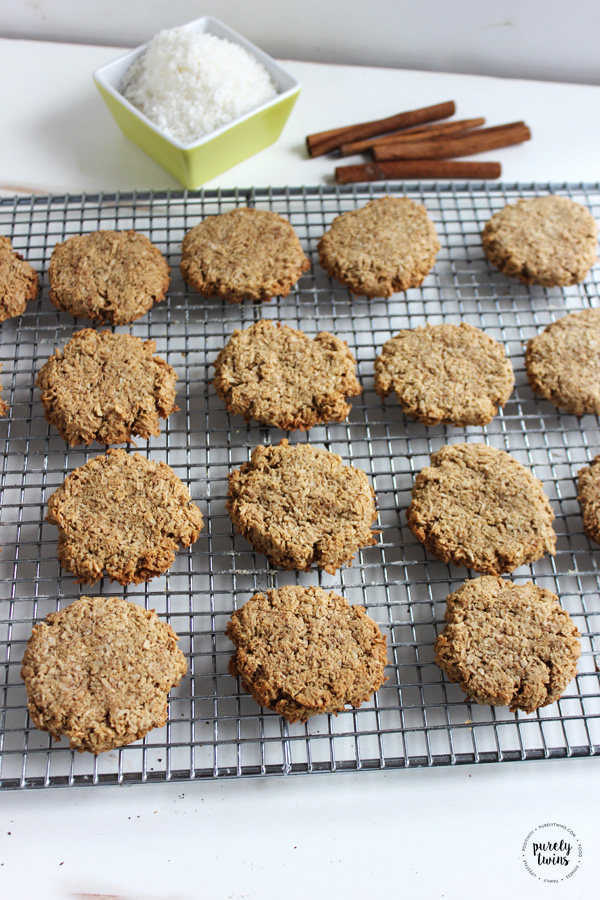 Tasty fun and super simple to make cinnamon chewy cookies. This cookie recipe is made from 4 ingredients from coconut flakes, maple, cinnamon and protein powder. No flour. No eggs. No refined sugars.
